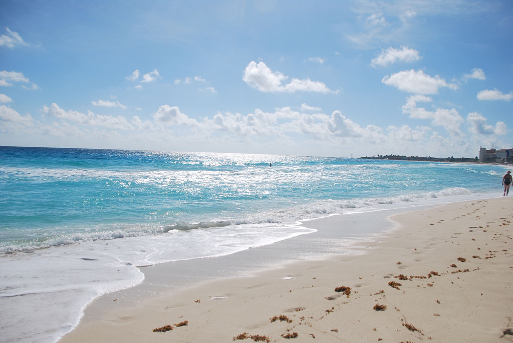 footprints in the sand on tropical Caribbean Beach ocean view