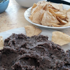 refried beans served with chips and salsa