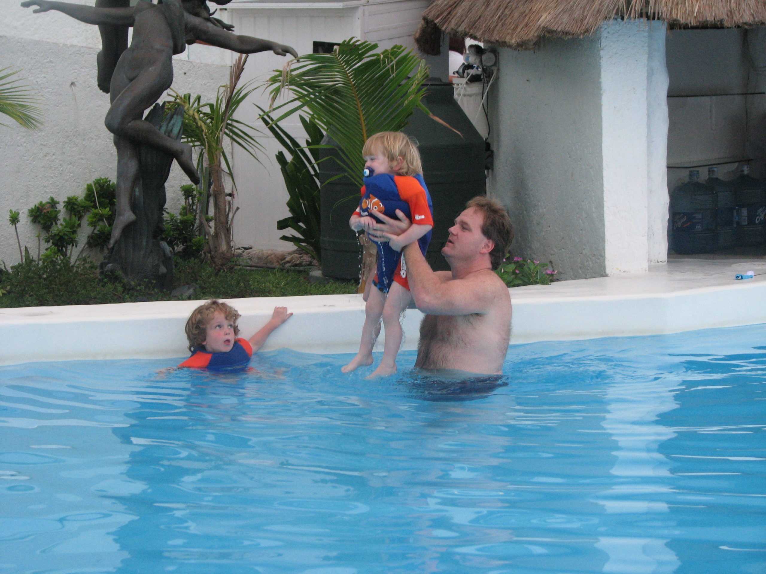 Dad playing with the boys in our pool Oleo Cancun